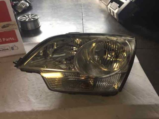2009 HOLDEN CAPTIVA CG MY10 5 (FWD) 5 SP MANUAL 2.4L MULTI POINT F/INJ HEADLIGHT LEFT