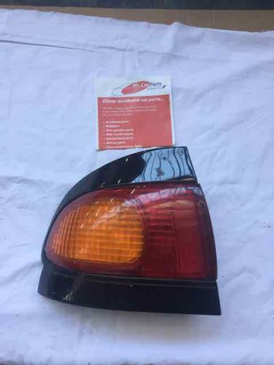 1994 FORD TELSTAR AX TX5 GHIA 4 SP AUTOMATIC 2.0L MULTI POINT F/INJ TAIL LIGHT LEFT