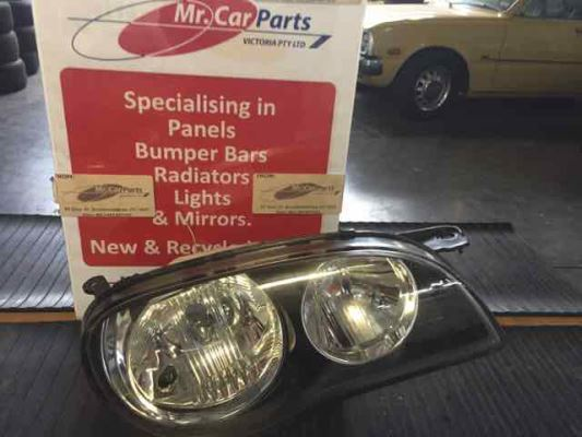1999 TOYOTA COROLLA AE112R CONQUEST 4 SP AUTOMATIC 1.8L MULTI POINT F/INJ HEADLIGHT RIGHT