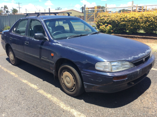 1994 HOLDEN APOLLO JM SLX 4 SP AUTOMATIC 2.2L MULTI POINT F/INJ DOOR 1/4 GLASS RR
